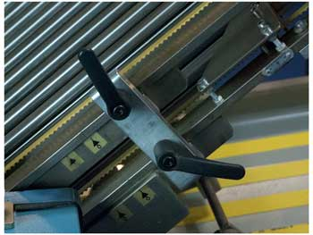 Levers of folding machine in different positions